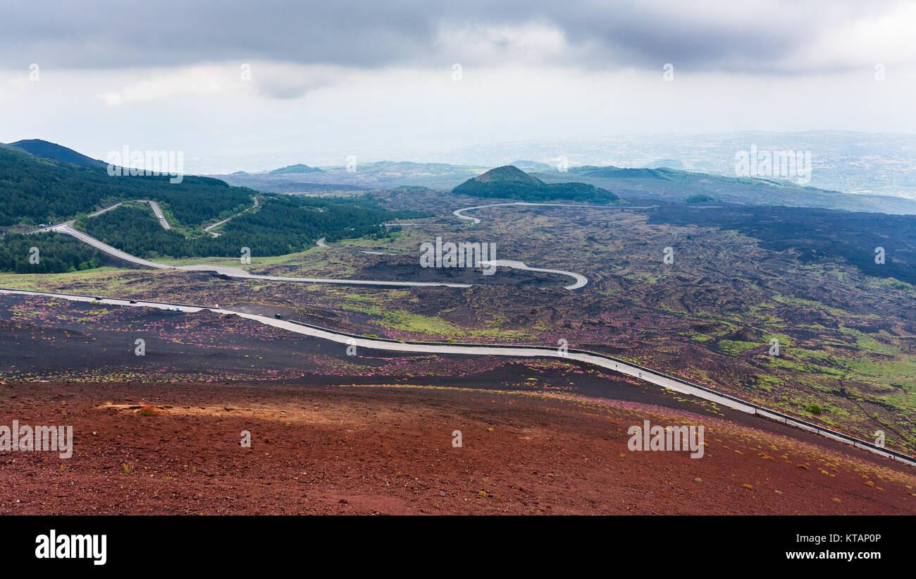 road in hardened lava fields on Mount Etna - Stock Image