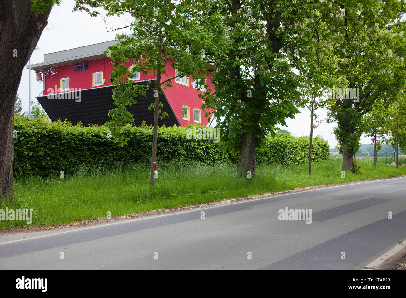 House upside down, Putbus, Ruegen island, Mecklenburg-Western Pomerania, Baltic Sea, Germany, Europe - Stock Image