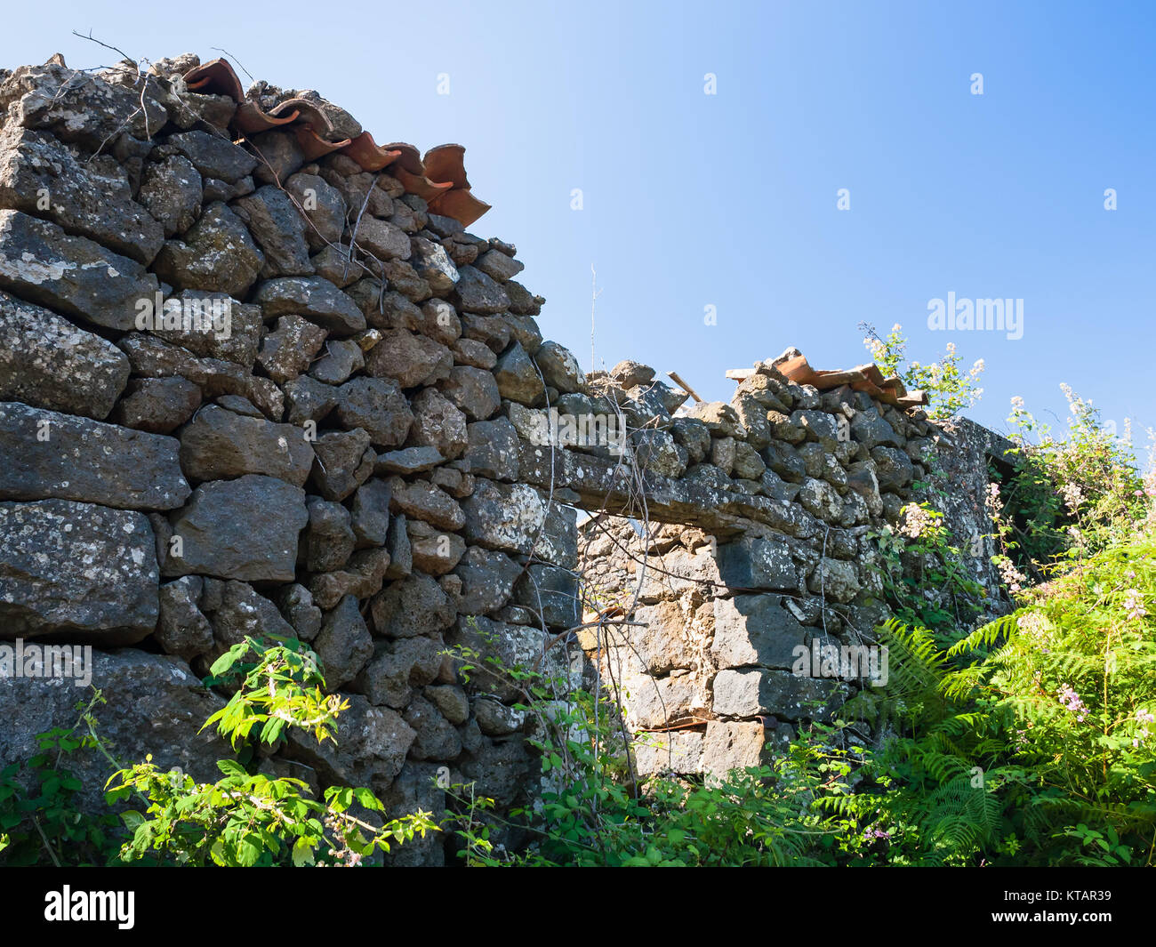 abandoned rural house after volcano Etna eruptio Stock Photo