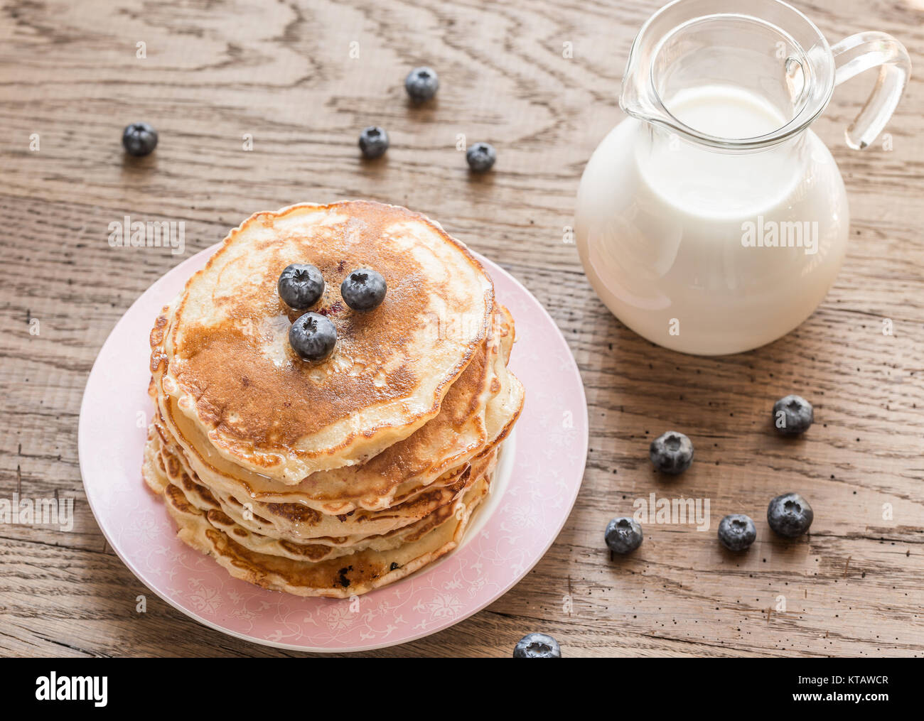 Pancakes with maple syrup and fresh blueberries Stock Photo