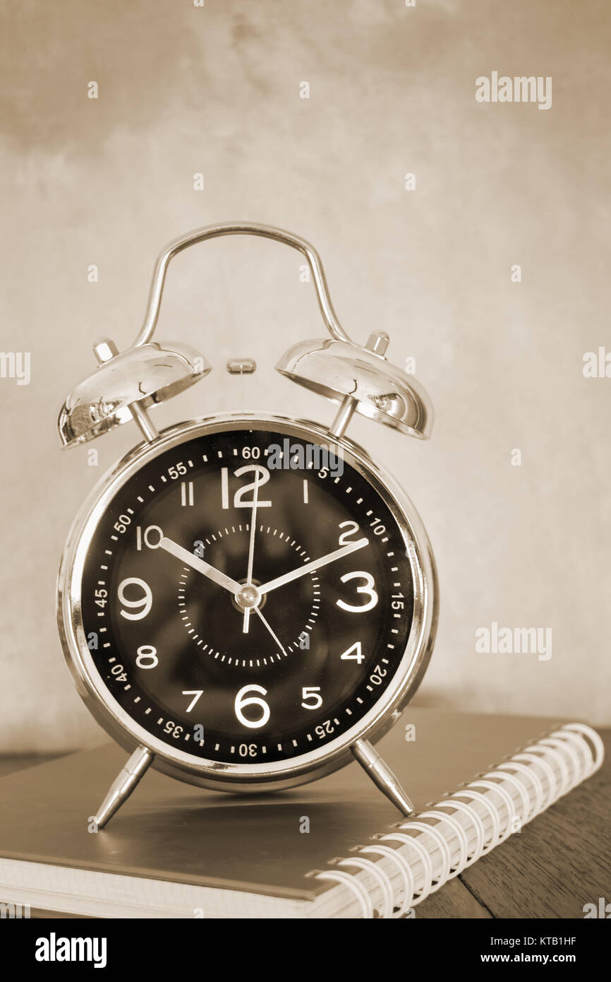 Alarm Clock On Wooden Work Table - Stock Image