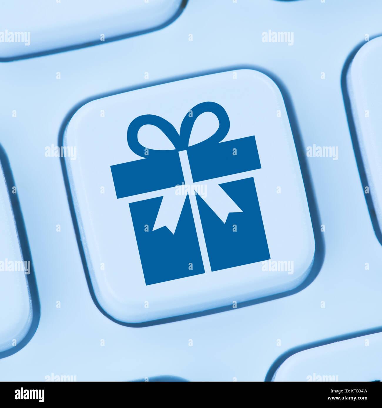Geschenke Geschenk online Shopping einkaufen bestellen Internet blau Computer web Tastatur - Stock Image