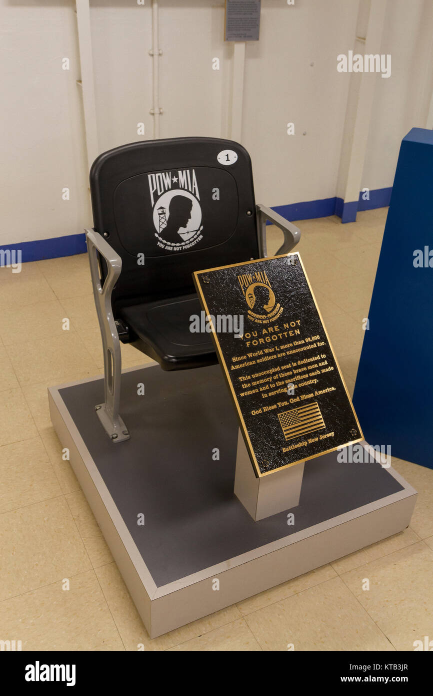 Unoccupied seat memorial chair to POW and MIA soldiers on the USS New Jersey Iowa Class Battleship, Delaware River, - Stock Image