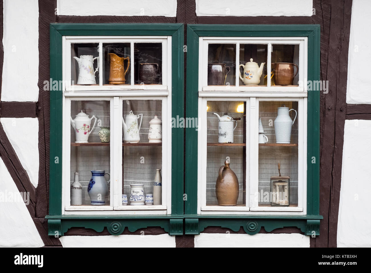 window decorated with coffee pots Stock Photo