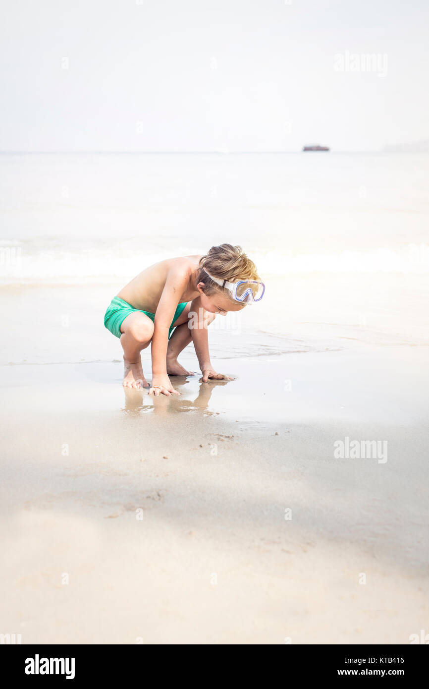 cute little boy with diving glasses at the beach - Stock Image