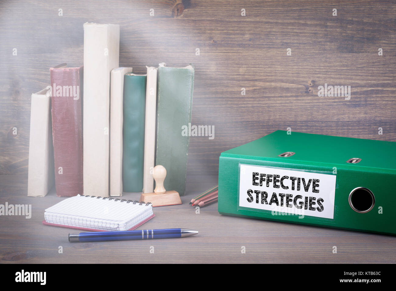 Effective Strategies. Binder on desk in the office. Business background. - Stock Image