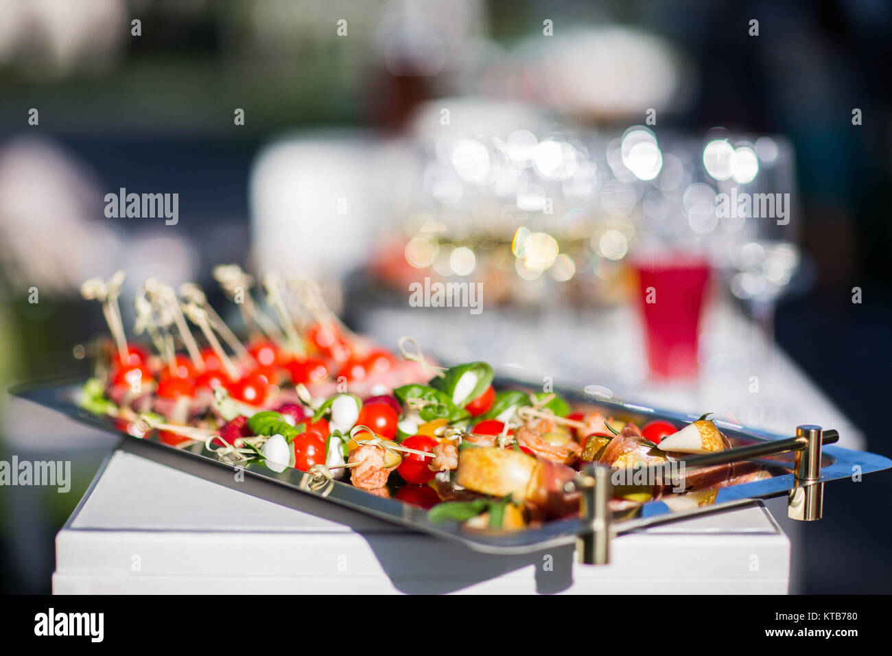 Canapes on a silver tray close up. - Stock Image