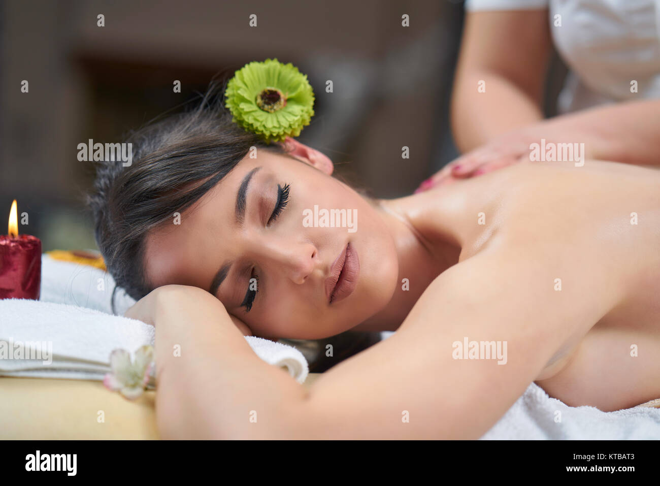 Spa woman. Female enjoying relaxing back massage in cosmetology spa centre. Body care, skin care, wellness, wellbeing, Stock Photo
