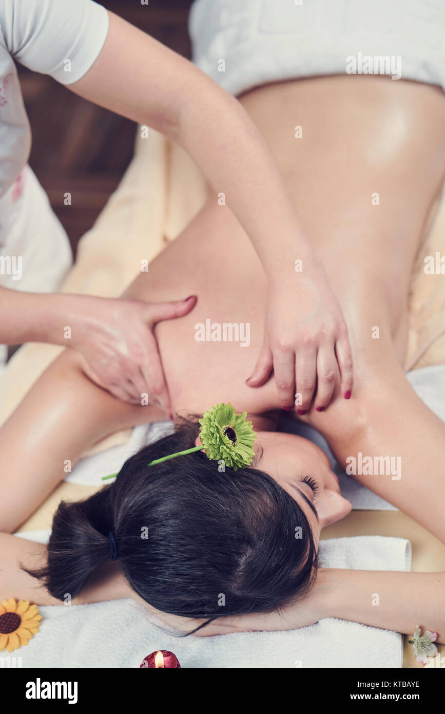 Spa woman. Female enjoying relaxing back massage in cosmetology spa centre. Body care, skin care, wellness, wellbeing, - Stock Image