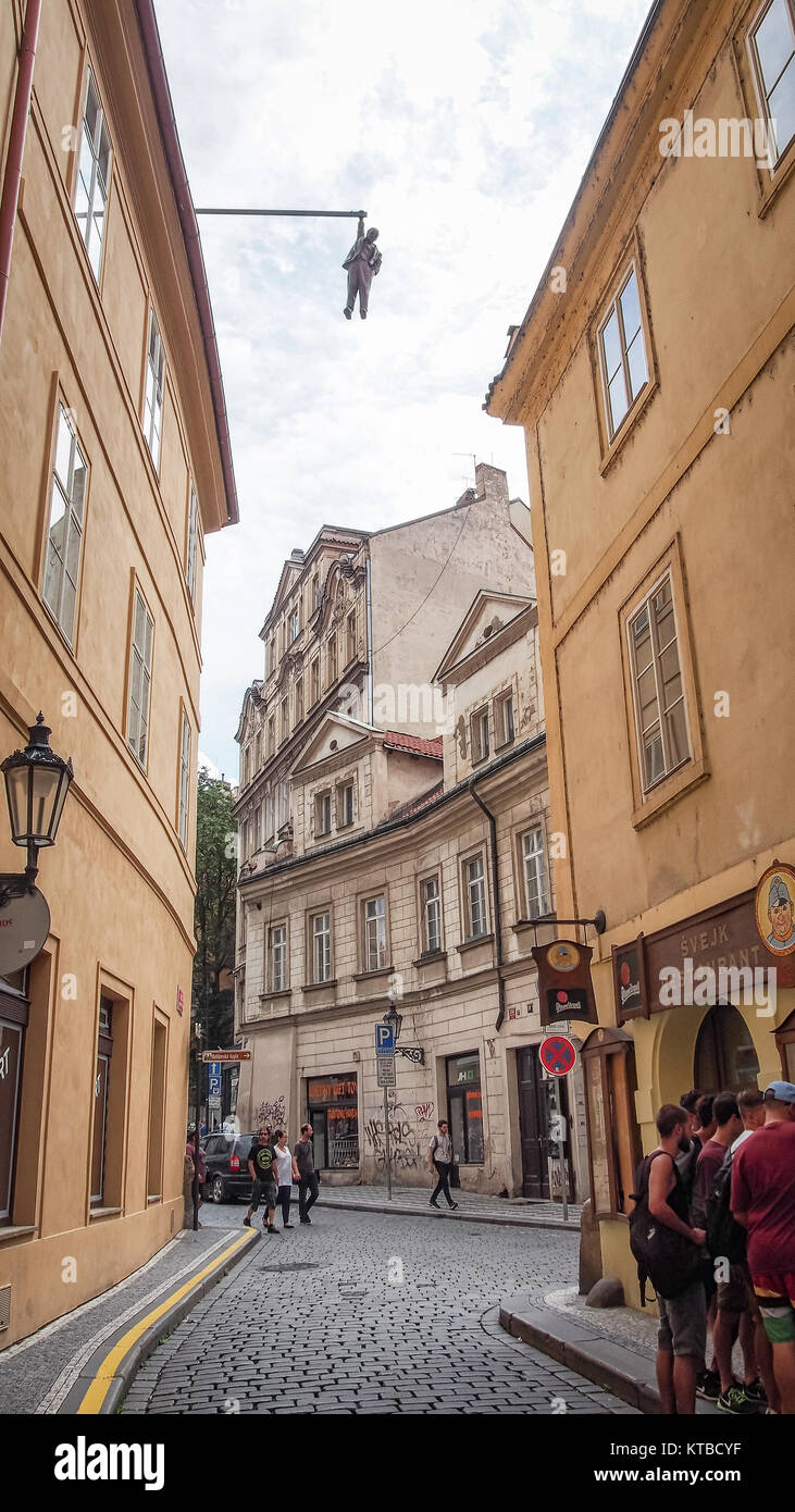 PRAGUE, CZECH REPUBLIC-JULY 23, 2016: Statue of Sigmund Freud hanging by one hand by David Cerny in the Husova street. - Stock Image