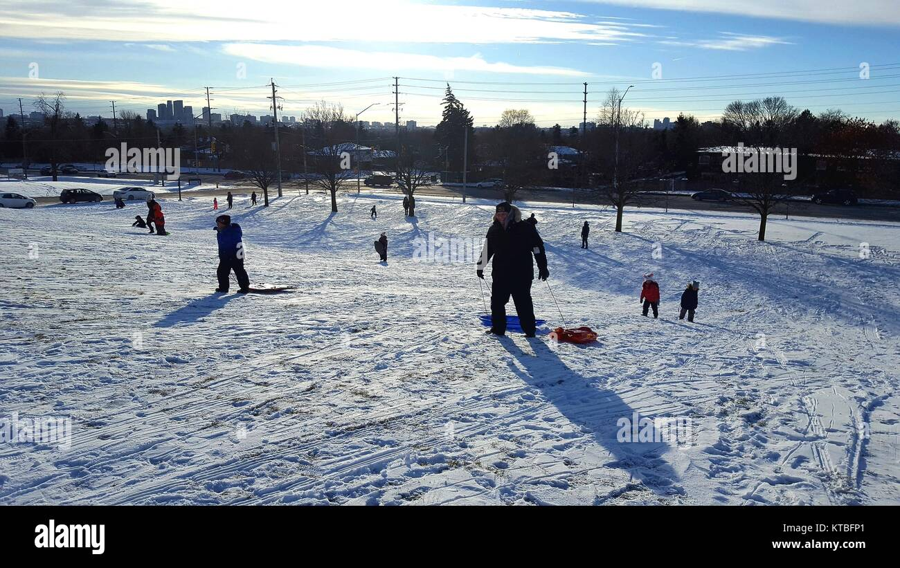 Families playing in the snow Stock Photo