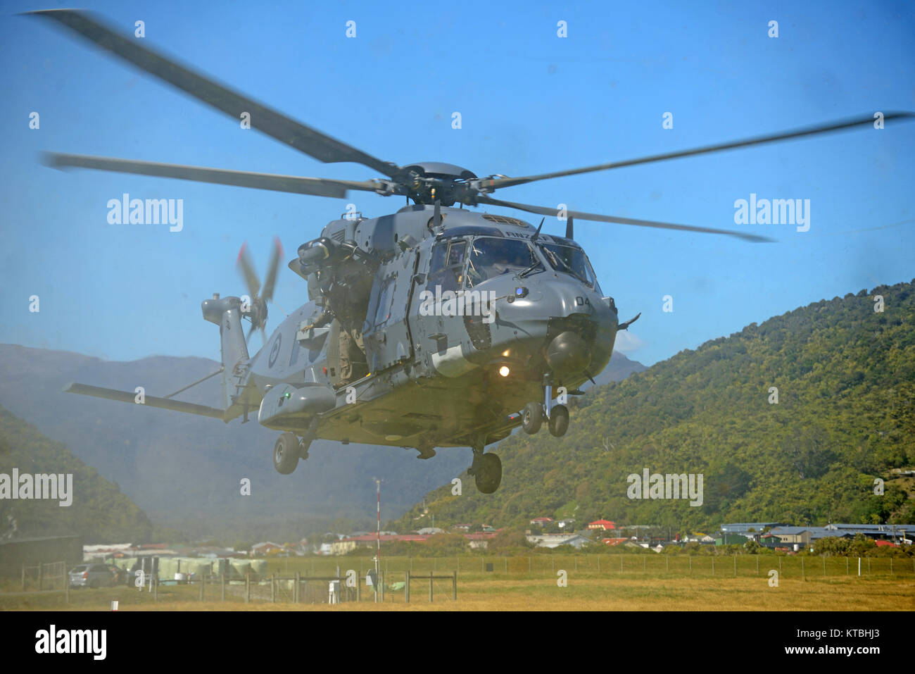 GREYMOUTH, NEW ZEALAND, NOVEMBER 18, 2017: Dust and flying debris obscure an Air Force NH90 helicopter taking off - Stock Image