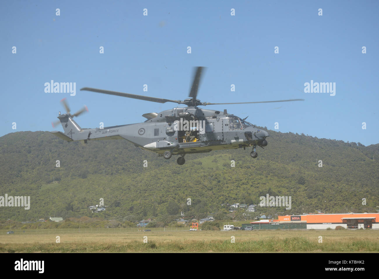 GREYMOUTH, NEW ZEALAND, NOVEMBER 18, 2017: Dust obscures an Air Force NH90 helicopter taking off at an open day - Stock Image