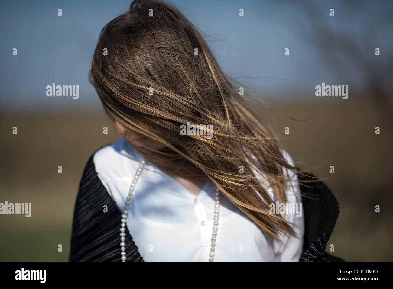 A girl in the wind - Stock Image