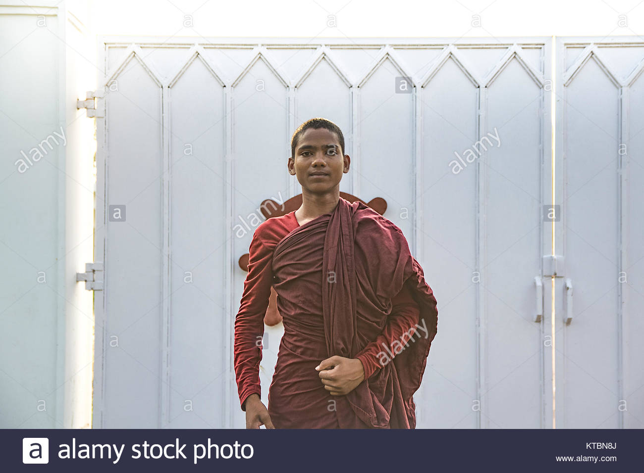 LUMBINI, NEPAL MAY 20, 2017: Portrait of young monk buddhist with beautiful tunic buddhist. - Stock Image