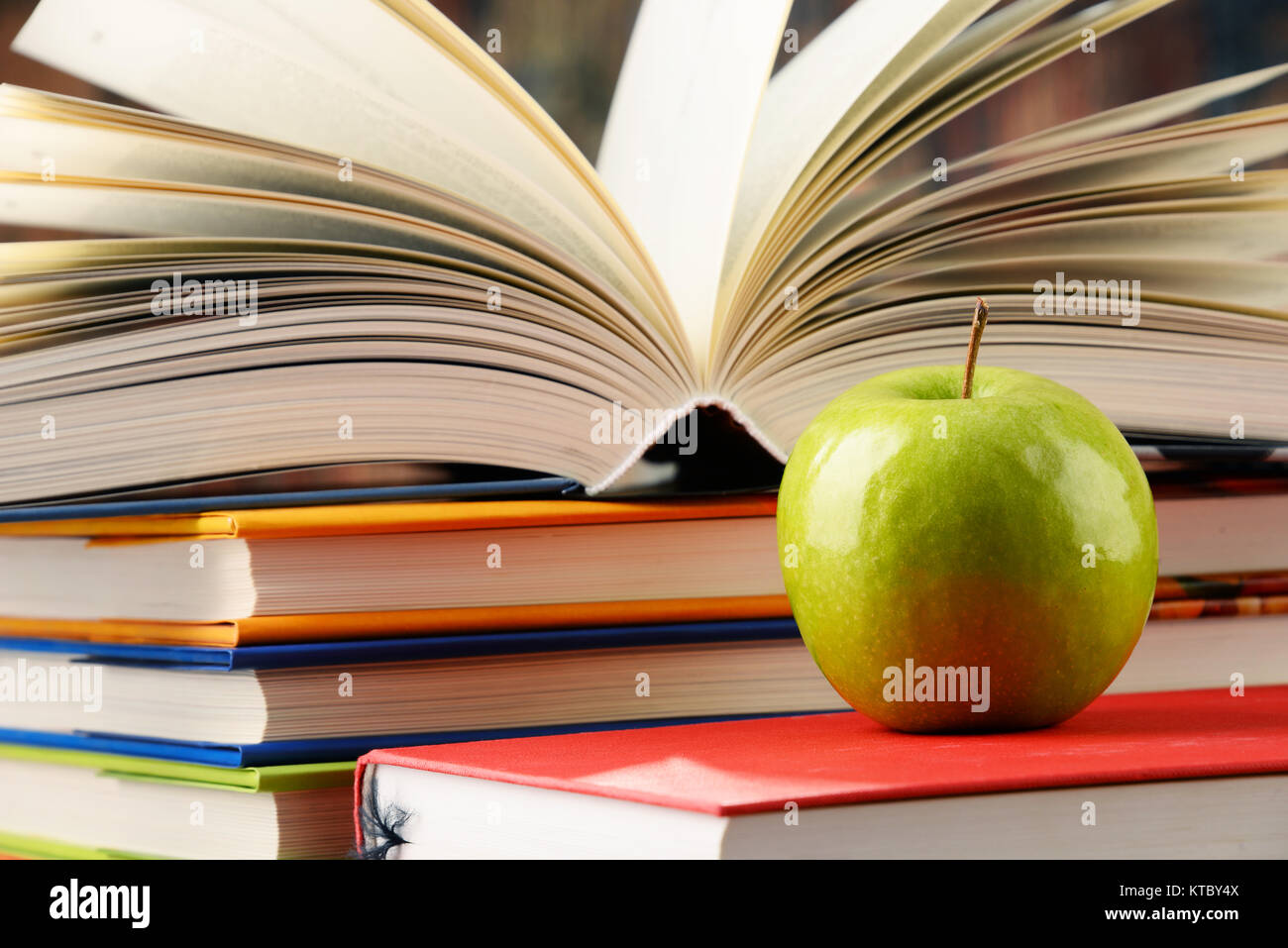 Composition with hardcover books and apple Stock Photo