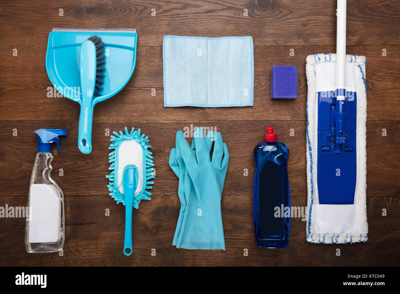 Cleaning Equipment On Wooden Desk - Stock Image