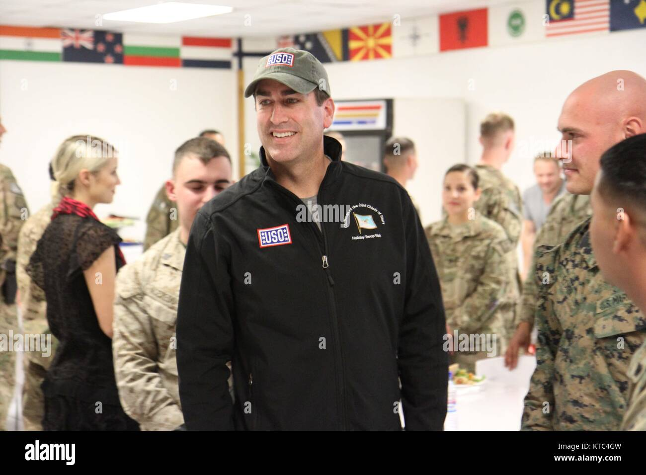 Comedian Rob Riggle chats with military service members during the USO Holiday troop visit at Bagram Air Field December - Stock Image