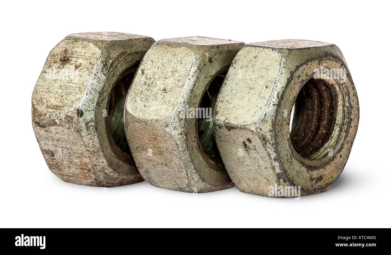 Three old rusty nuts in a row Stock Photo