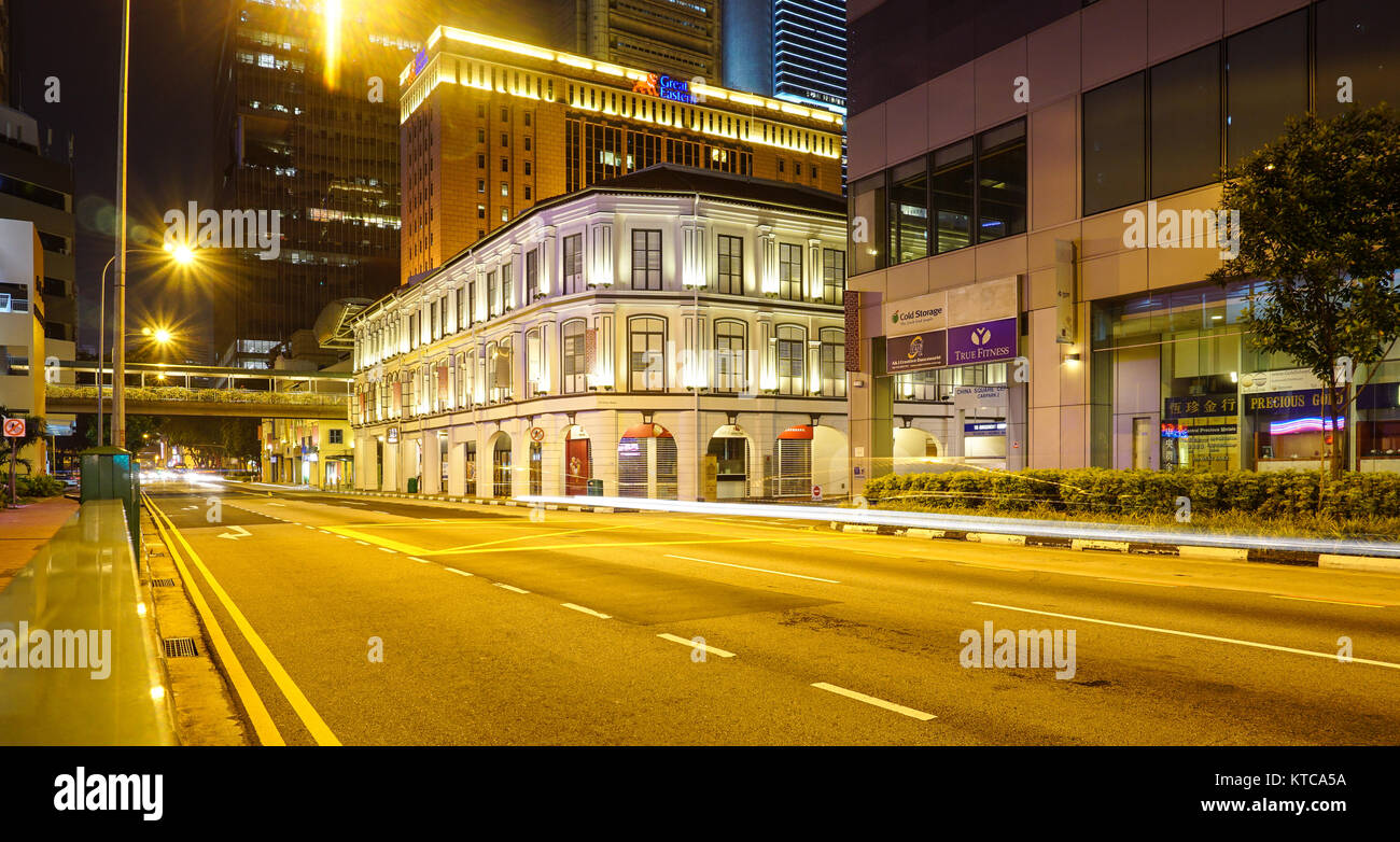 Singapore - Jul 5, 2015. Old buildings at night in Chinatown, Singapore. Chinatown is central with regard to hostel - Stock Image