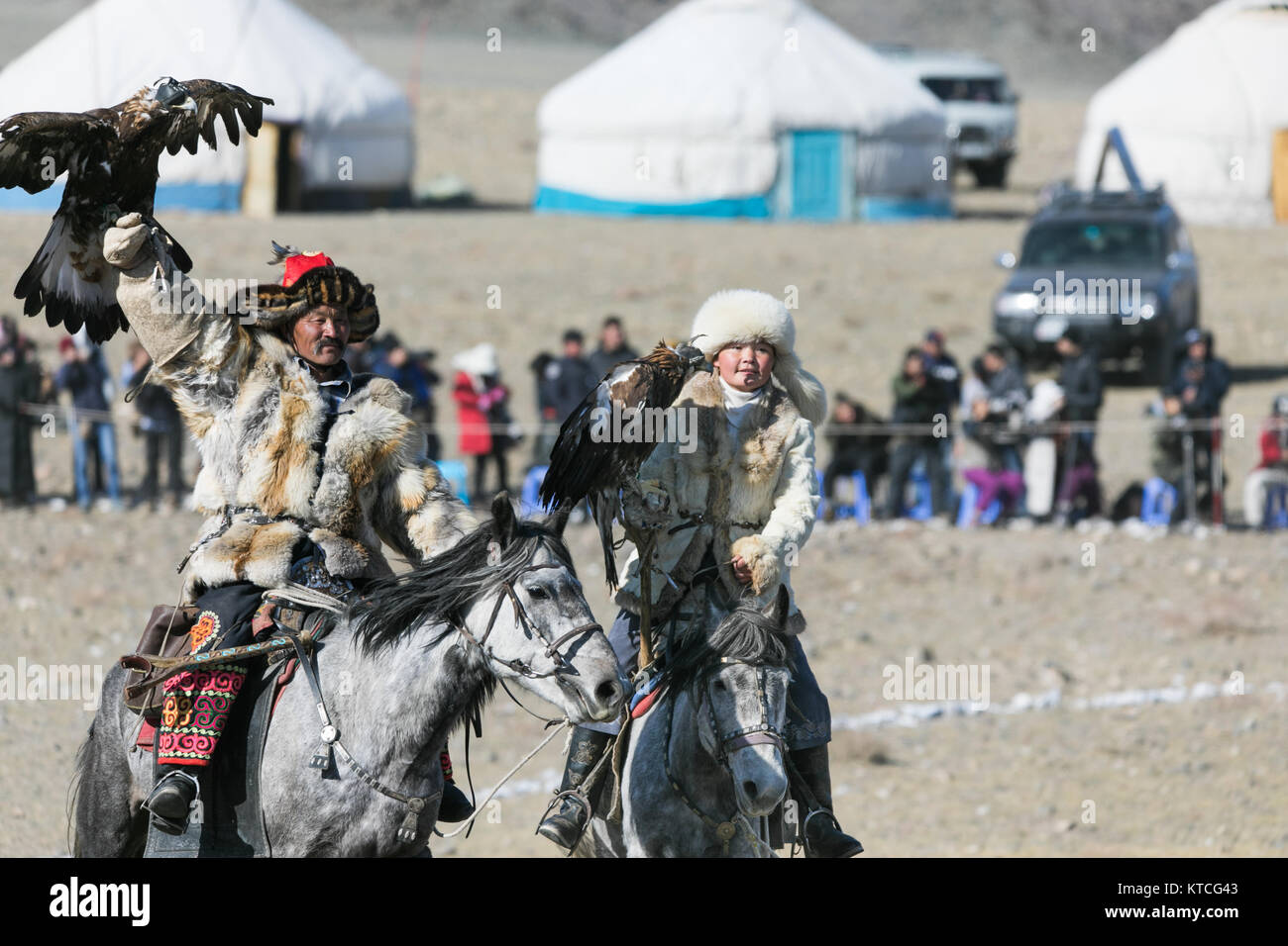 Aisholpan and her father from The Eagle Huntress at the Golden Eagle Festival in Mongolia - Stock Image
