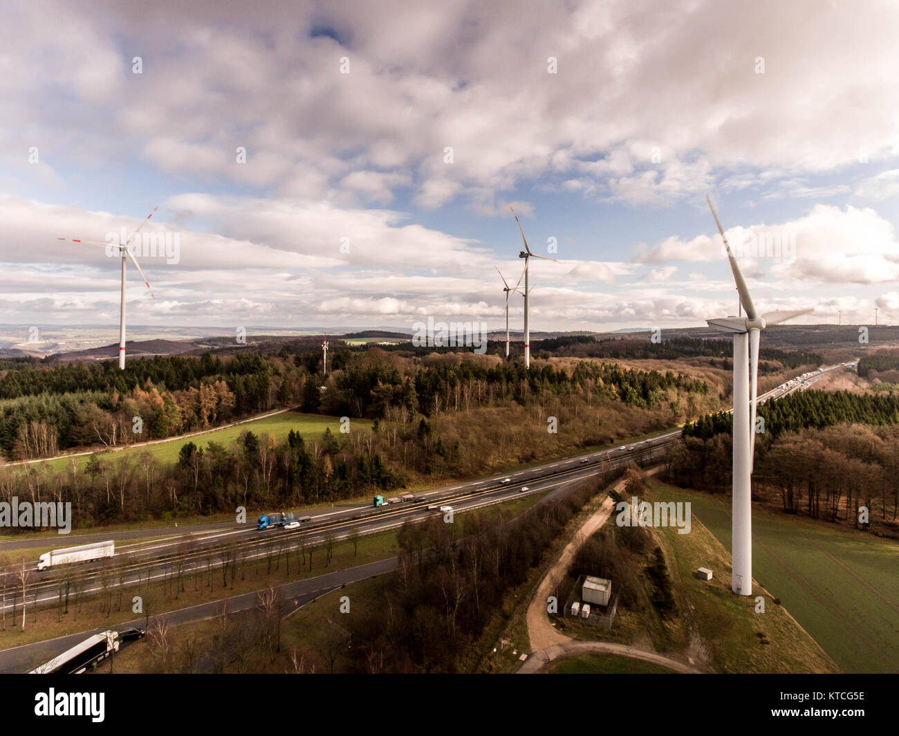 A panorama aerial helicopter view over wind farm landscape in