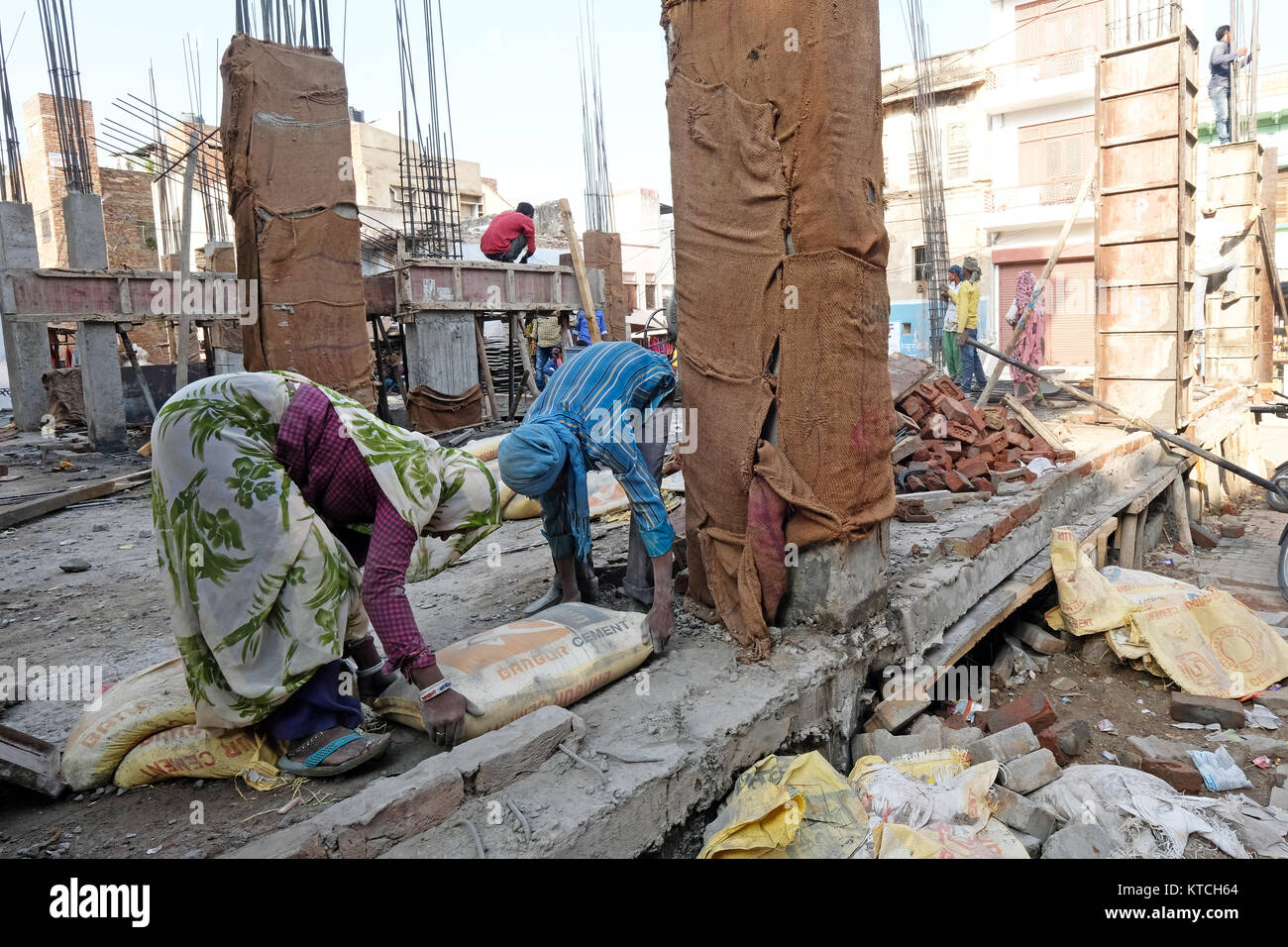 A building site in India with men and women labouring - Stock Image