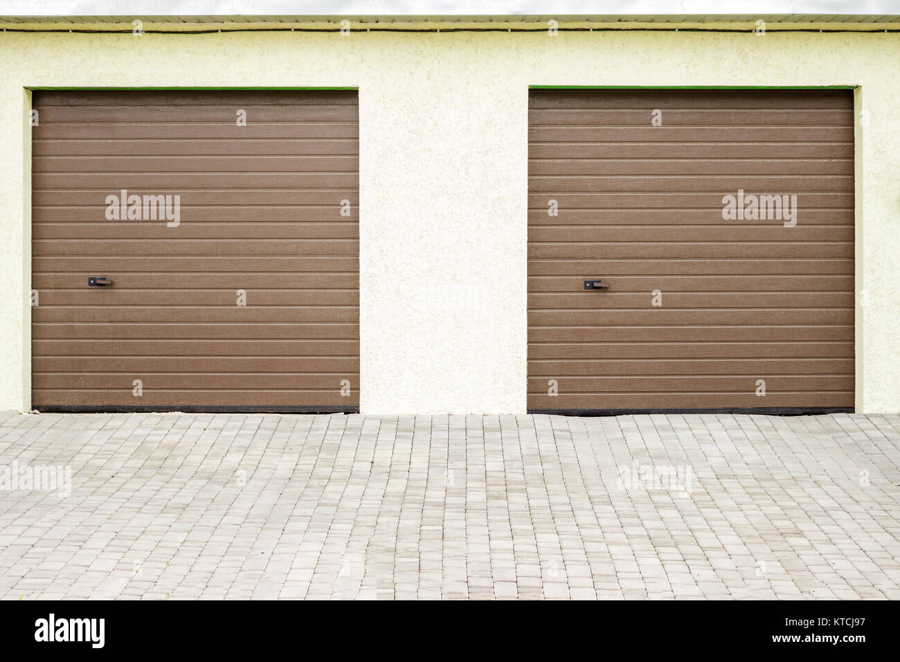 Pair of modern garage doors. Large automatic up and over garage doors for a wealthy holiday home. - Stock Image