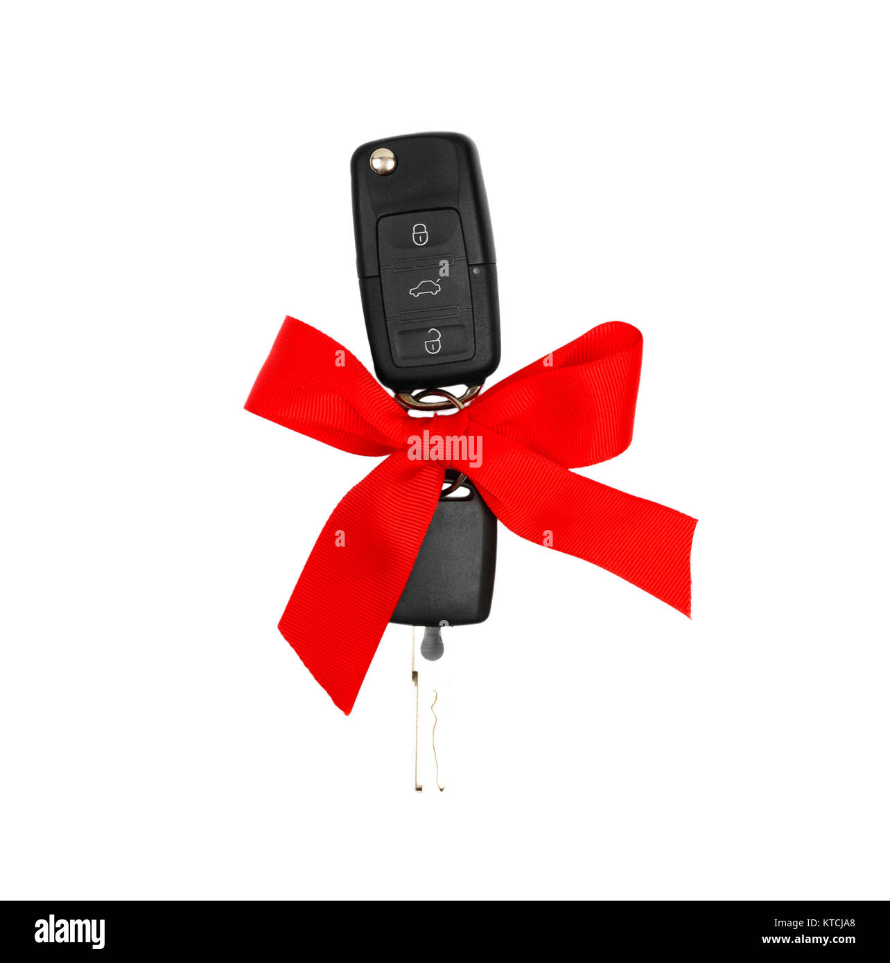 Car keys with red bow as present isolated on white. Stock Photo
