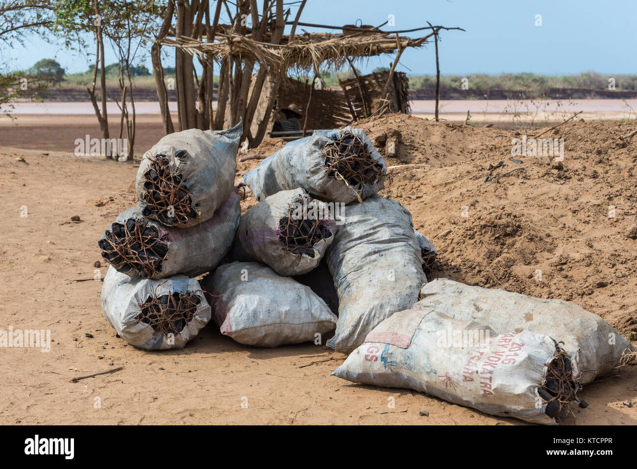 Sacks full of charcoal for sale. It's the main source of cooking fuel in rural Madagascar, Africa. - Stock Image