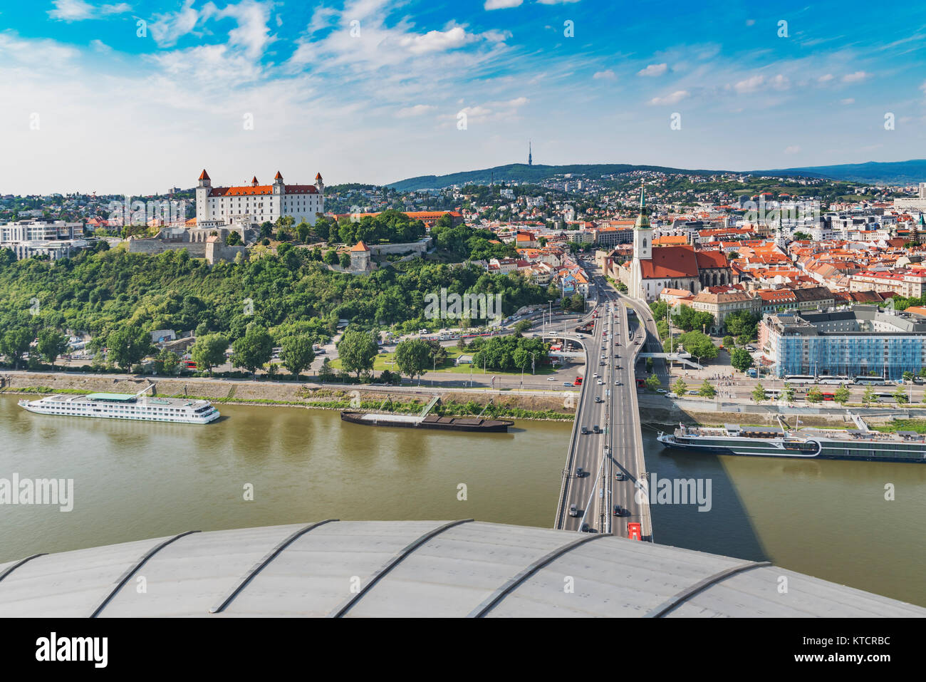 View from the 80 meter high lookout platform of the SNP bridge, the river Danube, Bratislava castle and St. Martin's - Stock Image