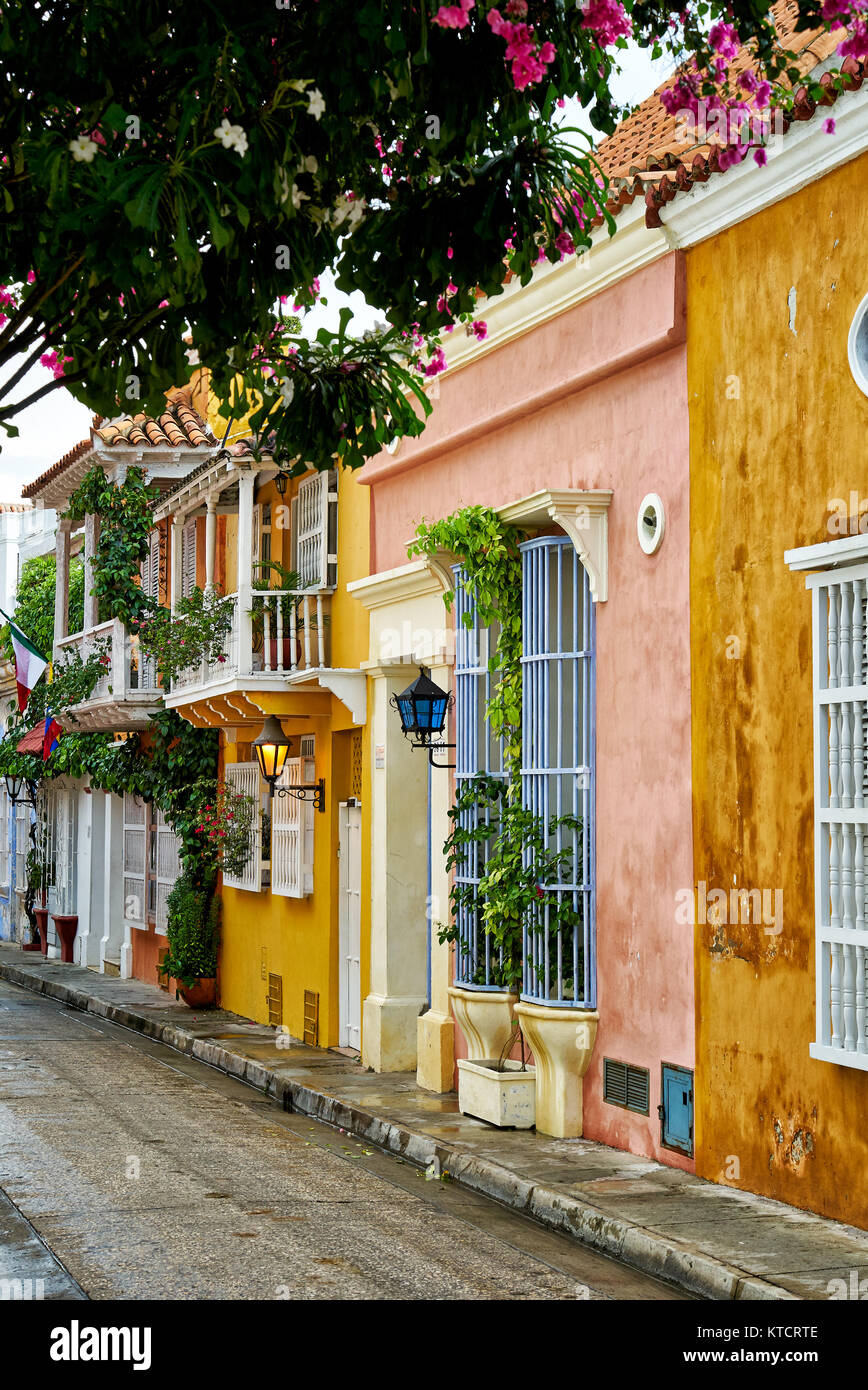 typical colorful facades with balconies of houses in Cartagena de Indias, Colombia, South America - Stock Image