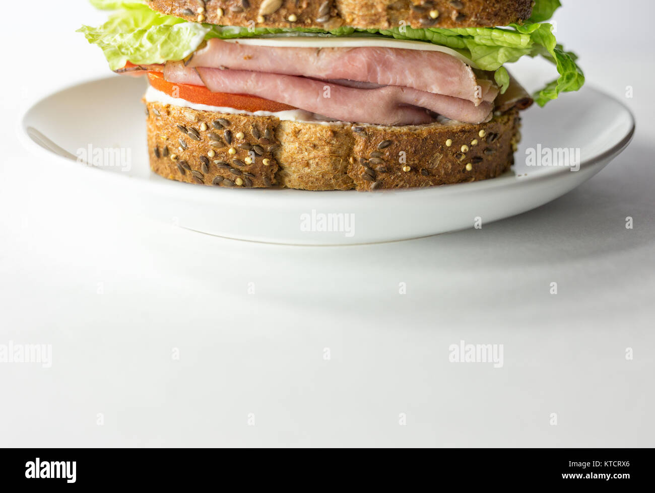 Ham Sandwich Made With Artisan Bread On A White Plate Copy Space Background