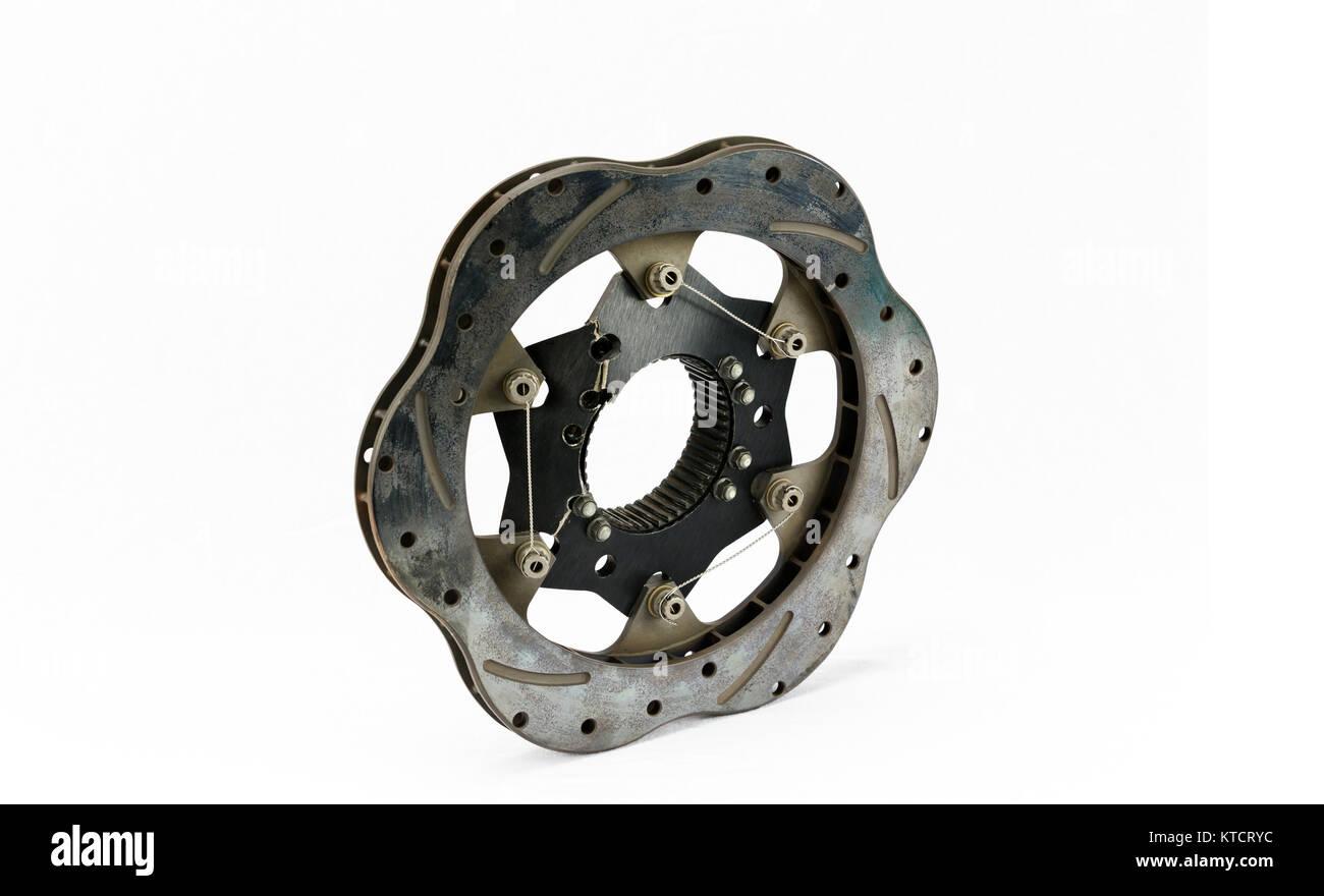 Broken, cracked and warped racing brake rotor. - Stock Image