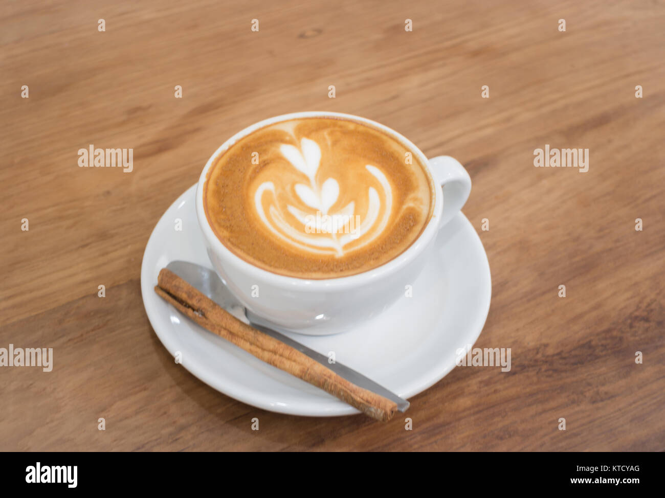 Coffee With Latte Art On Wooden Table - Stock Image