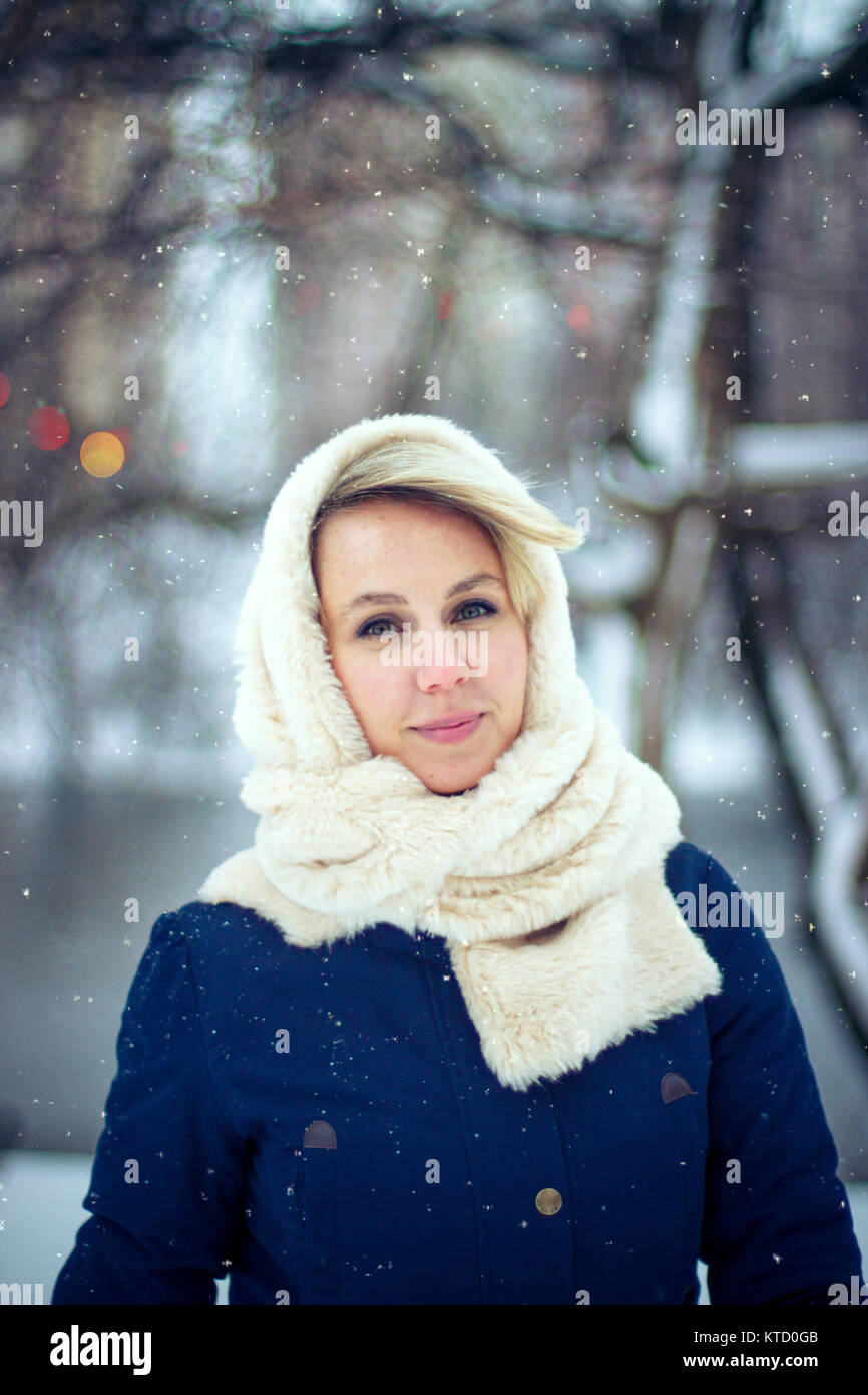 Winter girl walk in a park - Stock Image