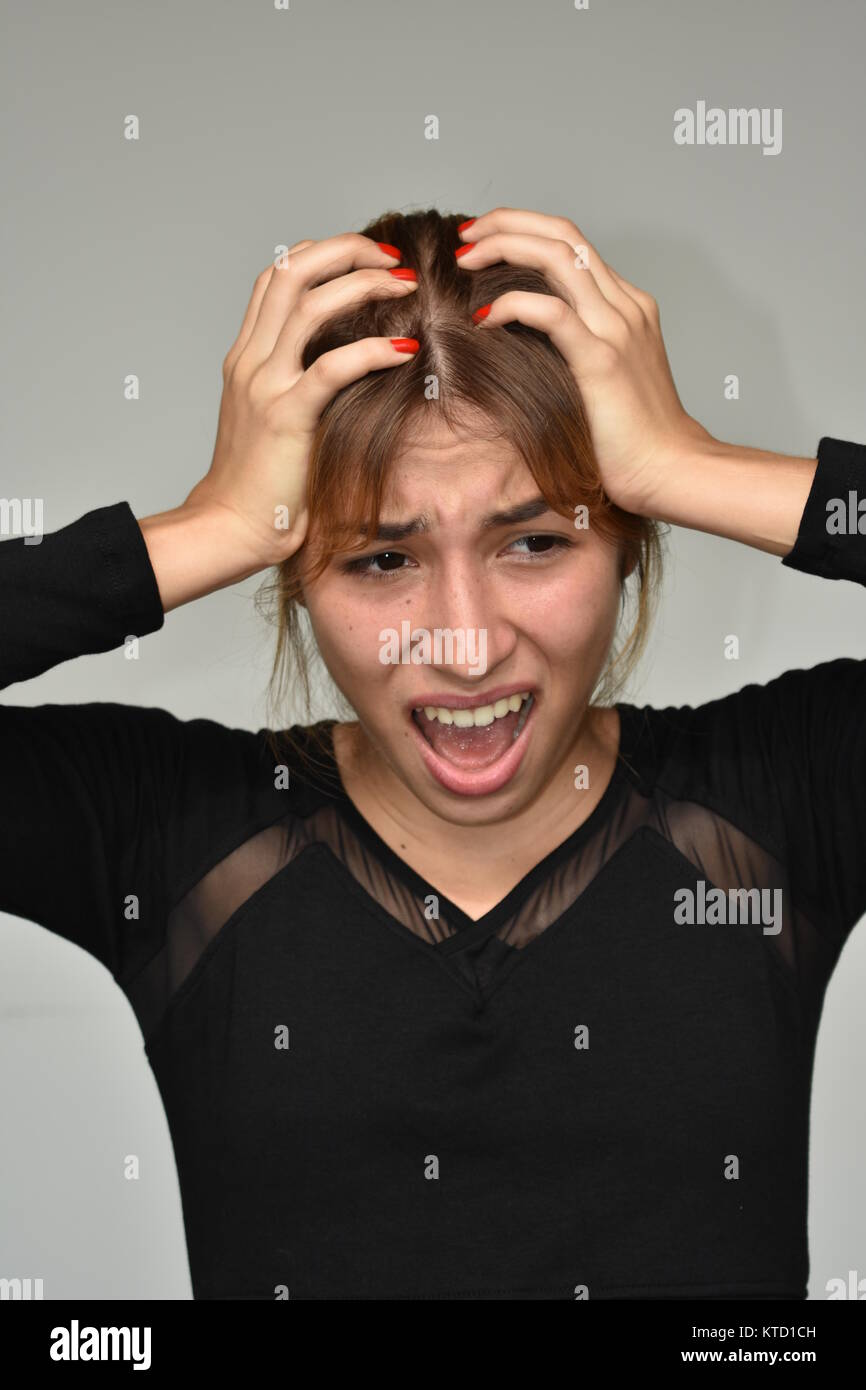 Stressful Latina Female - Stock Image