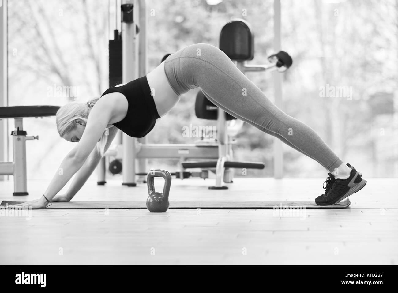 Kettlebell training in modern gym - Stock Image