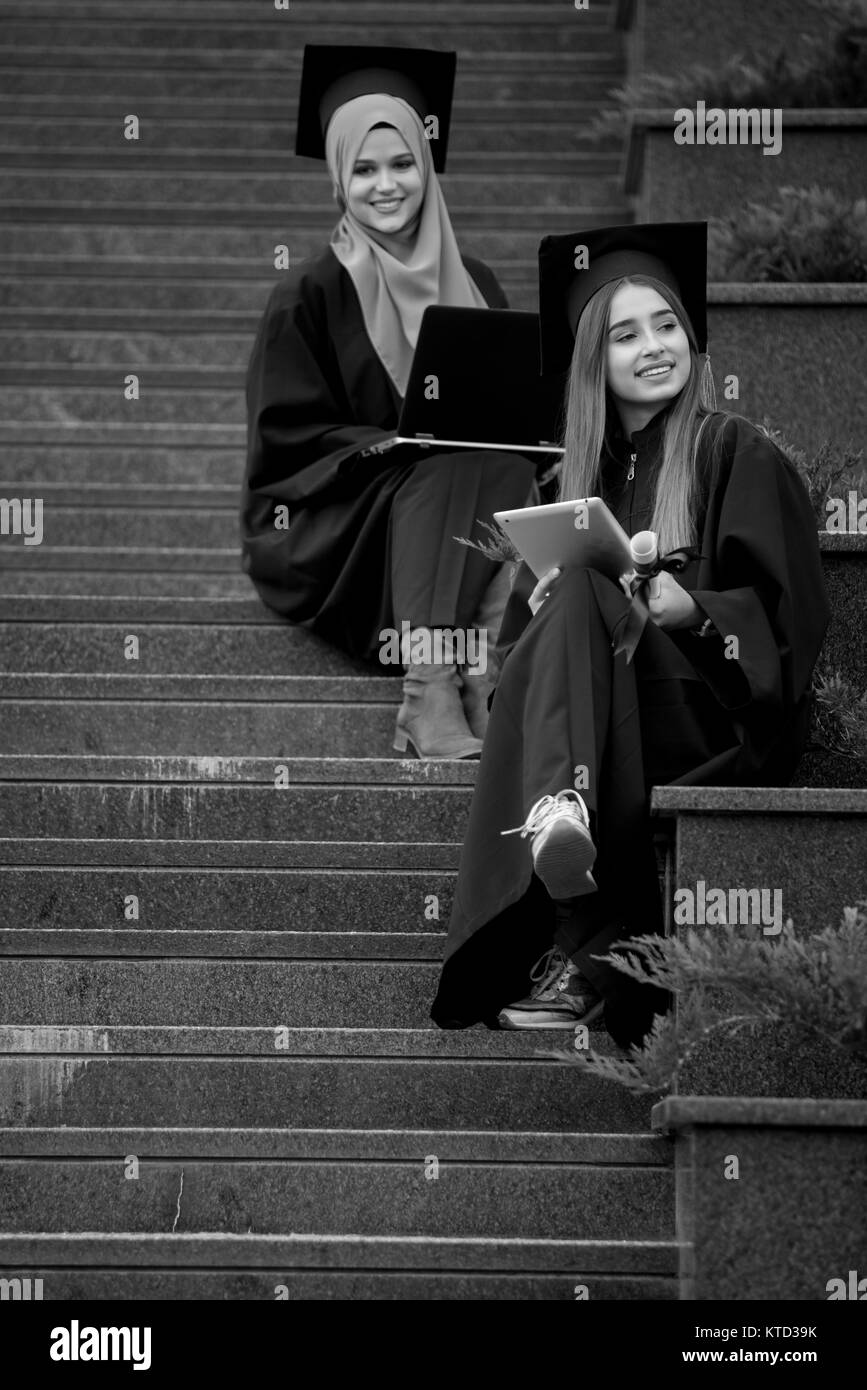 Girls graduating, collegues - Stock Image