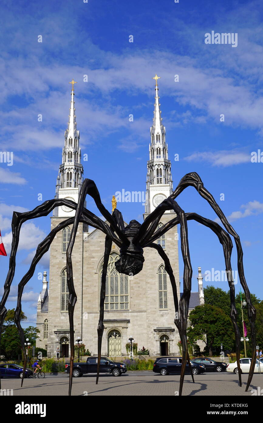 Maman, a bronze, stainless steel, and marble giant spider sculpture by the artist Louise Bourgeois at the National - Stock Image
