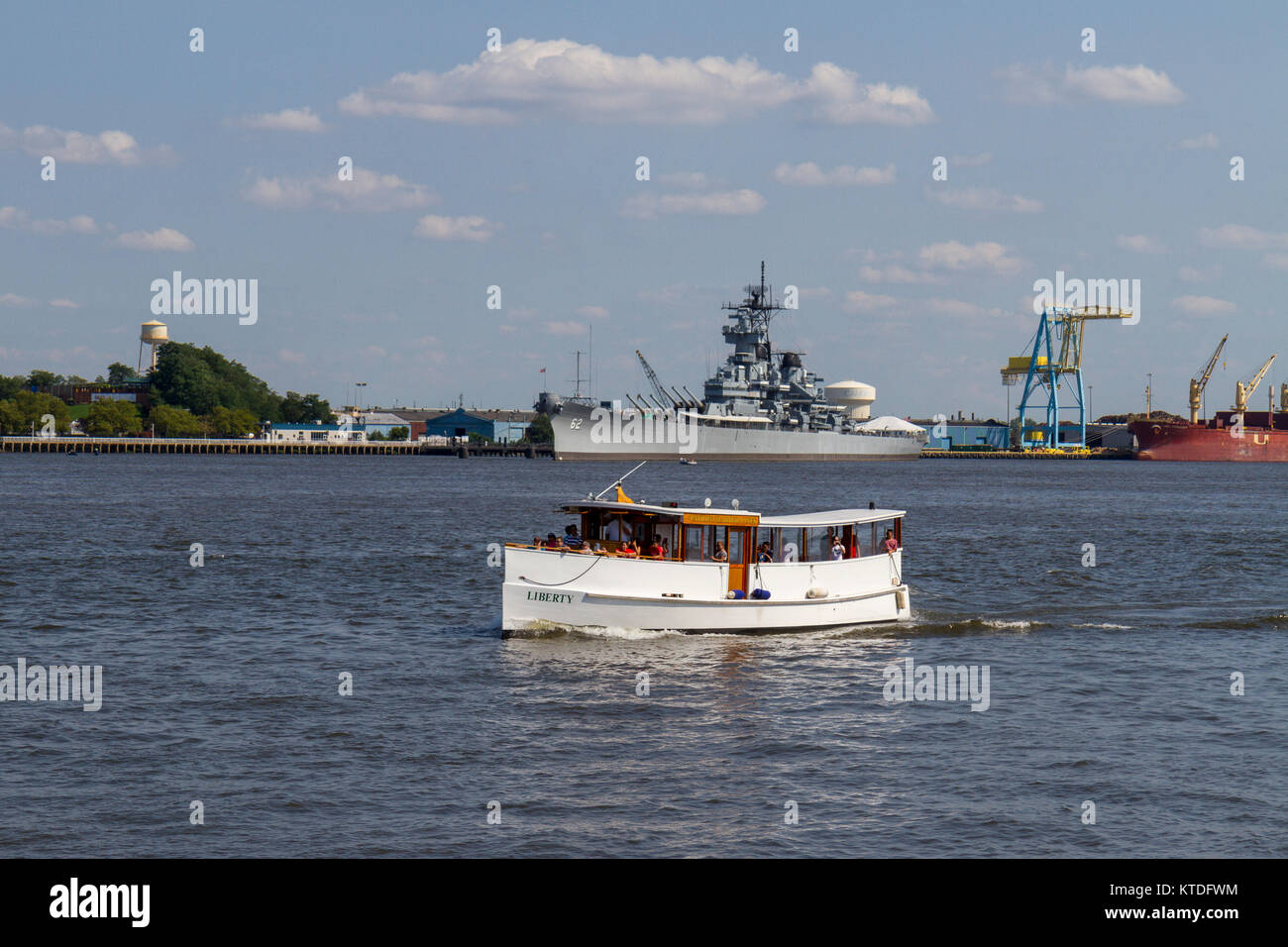 The Liberty tourist bost and the Battleship New Jersey, on the Delaware River, Camden, NJ, USA.  USS New Jersey - Stock Image
