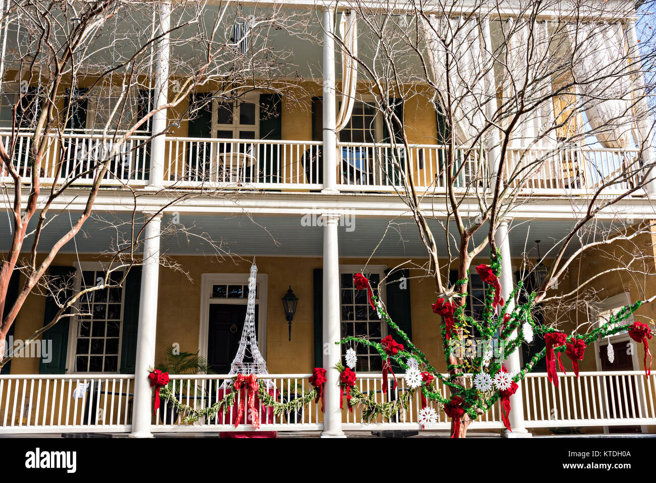 a historic home decorated for christmas on lagare street in charleston sc