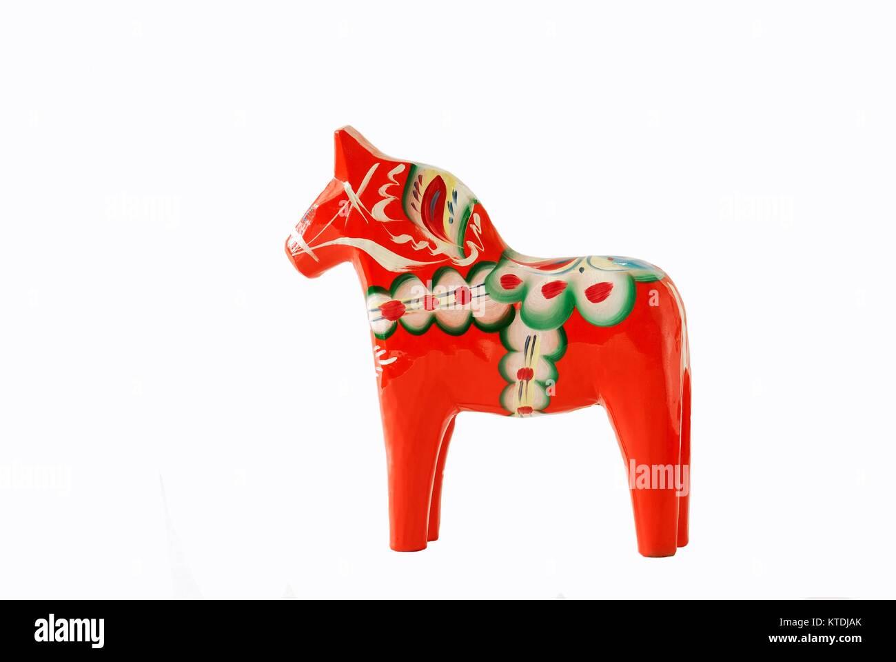 Swedish dalahorse figurine on a white background - Stock Image