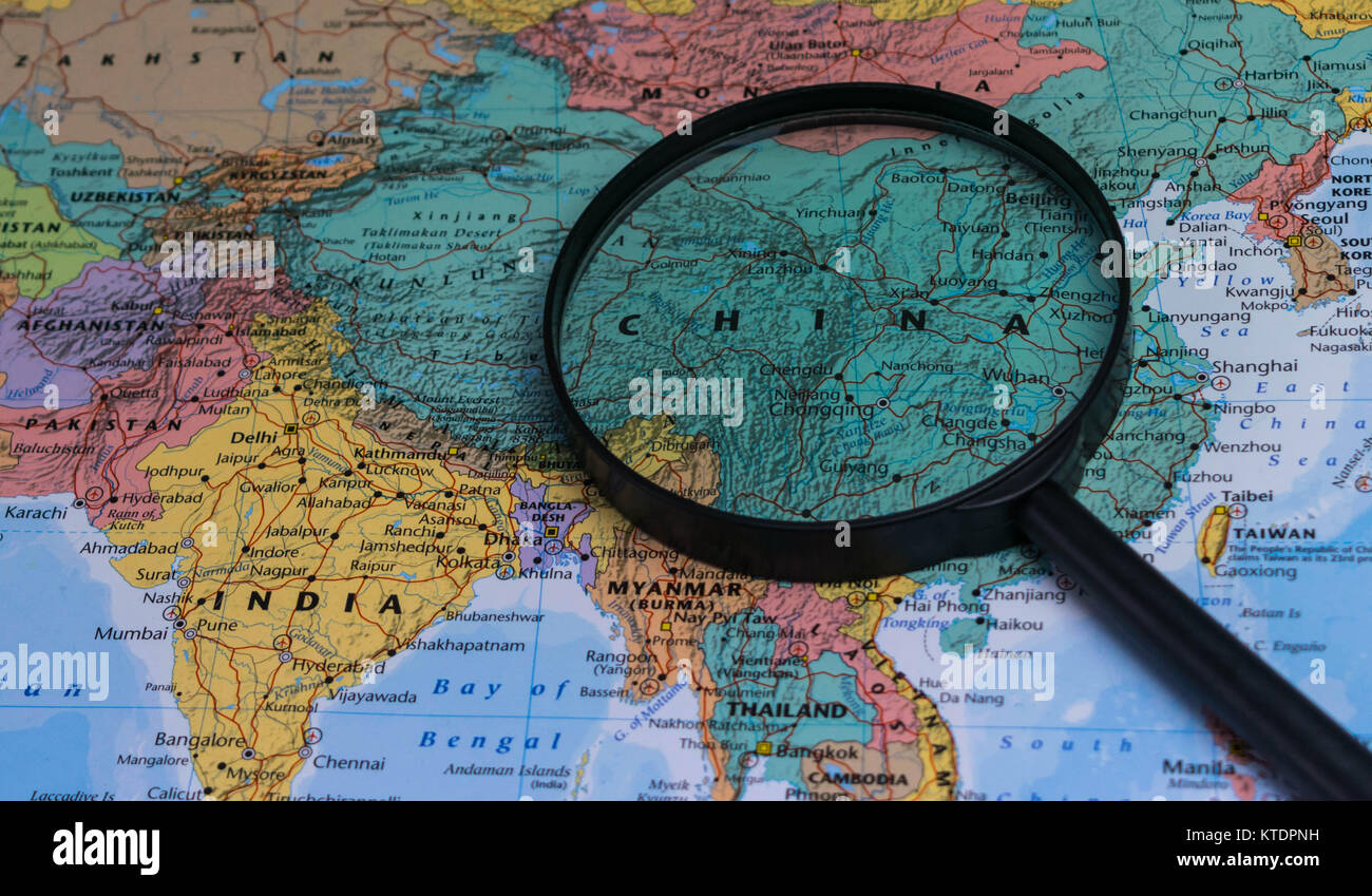 Map of china through magnifying glass on a world map stock photo map of china through magnifying glass on a world map gumiabroncs Gallery