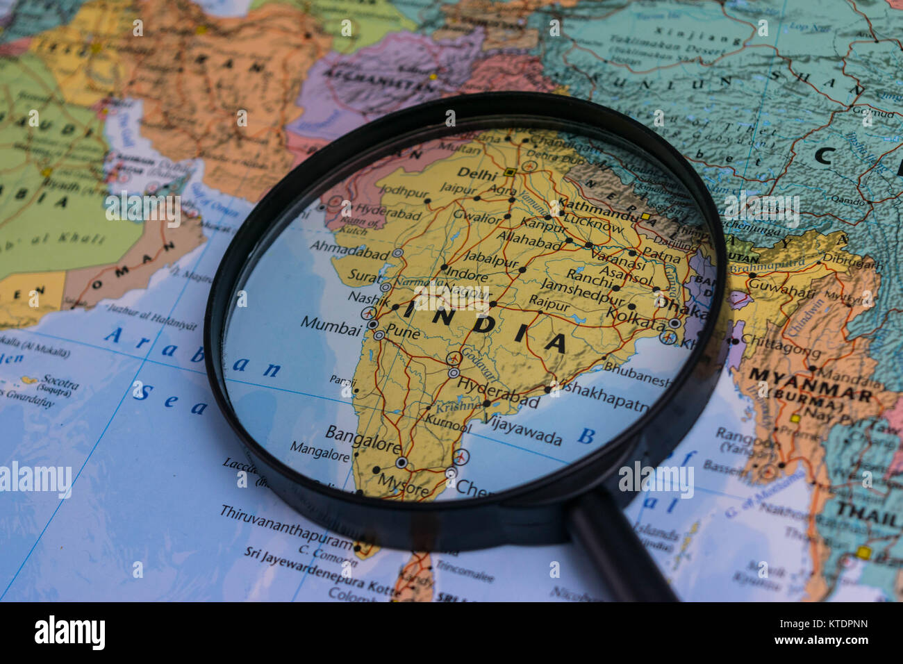 India map through magnifying glass on a world map stock photo india map through magnifying glass on a world map gumiabroncs Choice Image