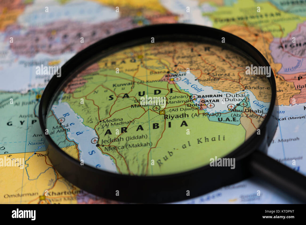 Magnify glass on a world map magnify stock photos magnify glass on saudi arabia map through magnifying glass on a world map stock image gumiabroncs Image collections