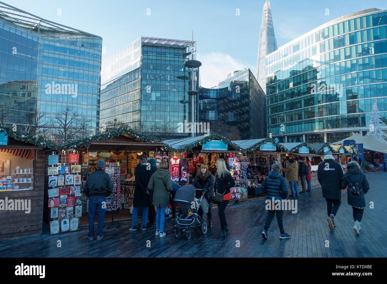 Christmas Market Stalls with The Shard Skyscraper and Modern Office Buildings on the South Bank River Thames London - Stock Image