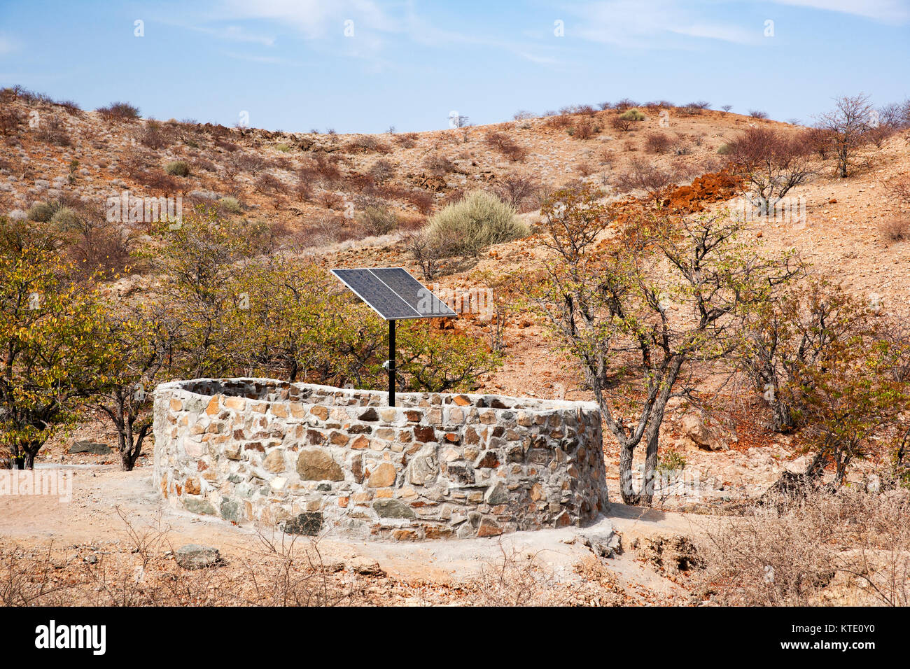 Solar water pump at borehole - Huab Under Canvas, Damaraland, Namibia, Africa - Stock Image