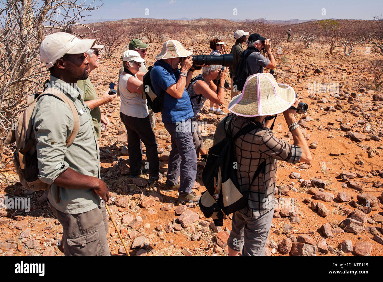 Group of people rhino trekking at Huab Under Canvas, Damaraland, Namibia, Africa - Stock Image