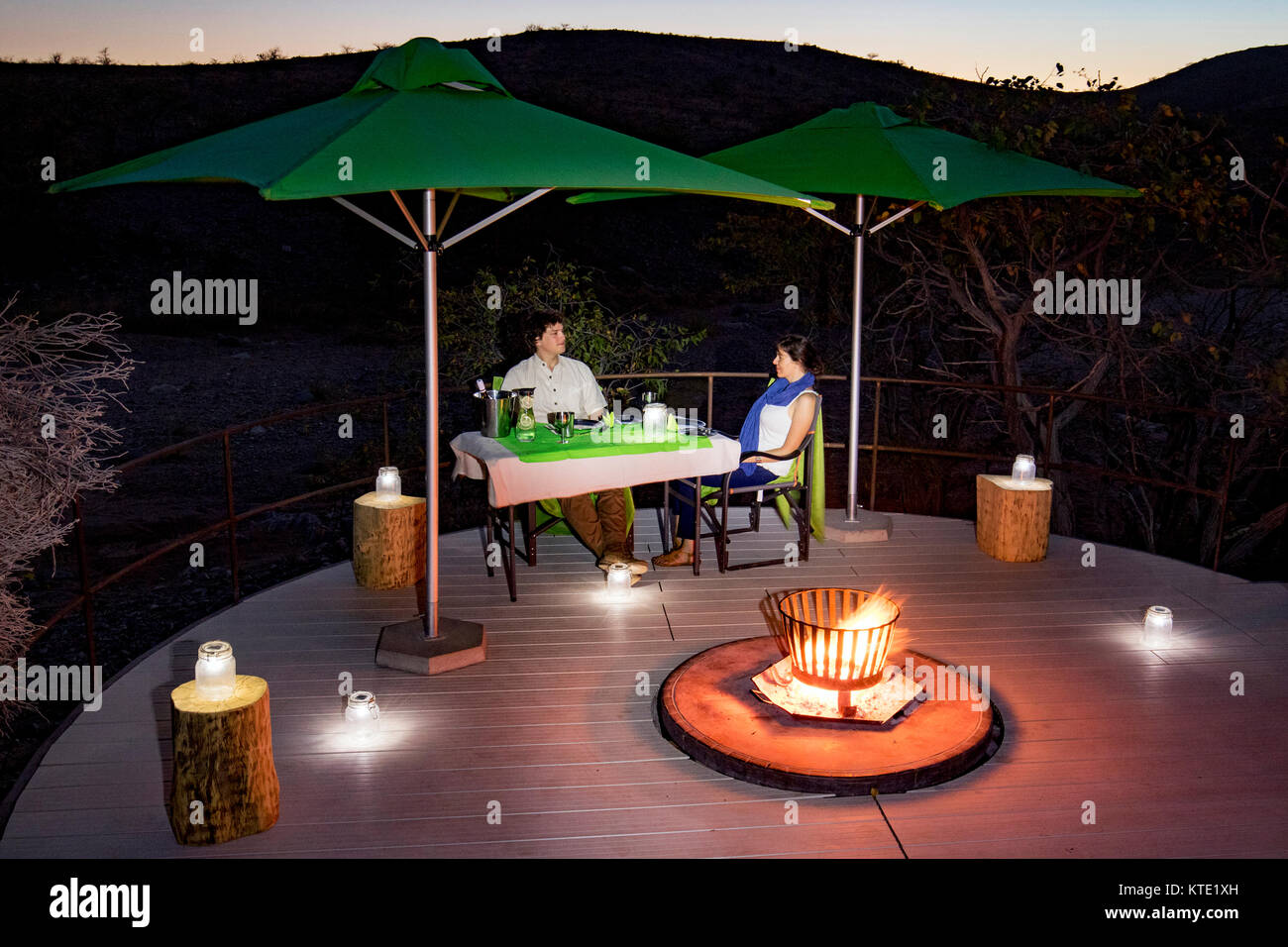 Romantic outdoor dining at Huab Under Canvas, Damaraland, Namibia, Africa - Stock Image